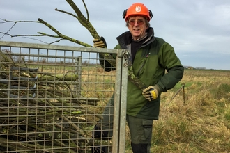 Martin Parsons loading and removing unwanted sallow that cannot be burnt on peat